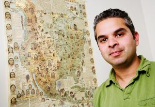 Ripan Malhi with a map behind him