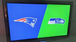 Patriots vs Seahawks YouTube TV Promo banner on a TV