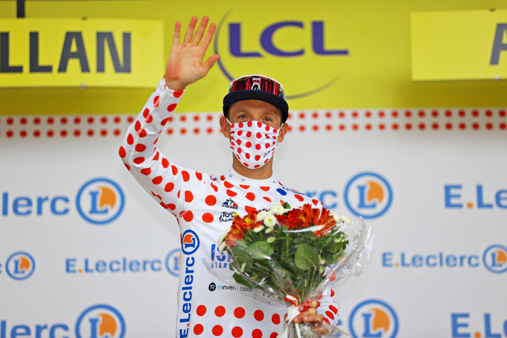 QUILLAN FRANCE JULY 10 Michael Woods of Canada and Team Israel StartUp Nation Polka Dot Mountain Jersey celebrates at podium during the 108th Tour de France 2021 Stage 14 a 1837km stage from Carcassonne to Quillan LeTour TDF2021 on July 10 2021 in Quillan France Photo by Tim de WaeleGetty Images