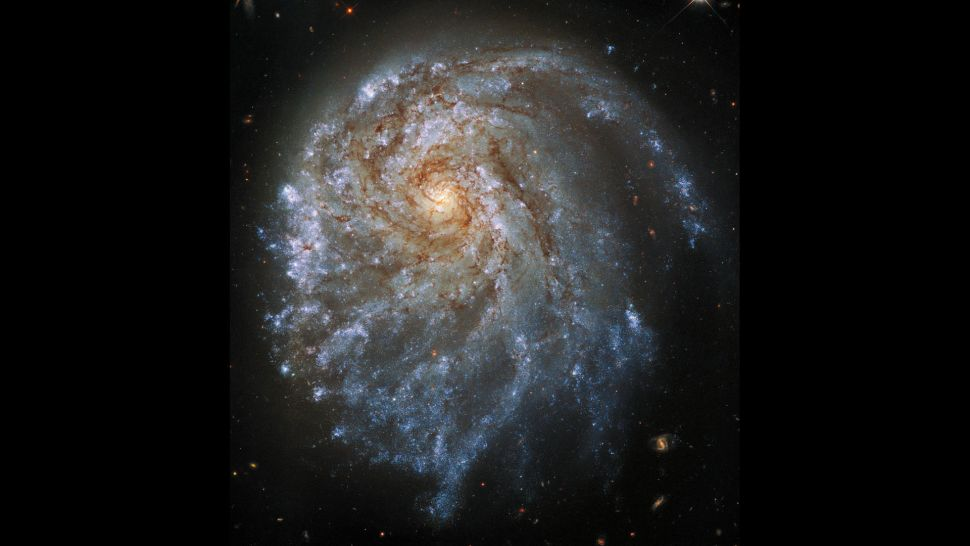 Hubble telescope spies lopsided spiral galaxy deformed by gravity