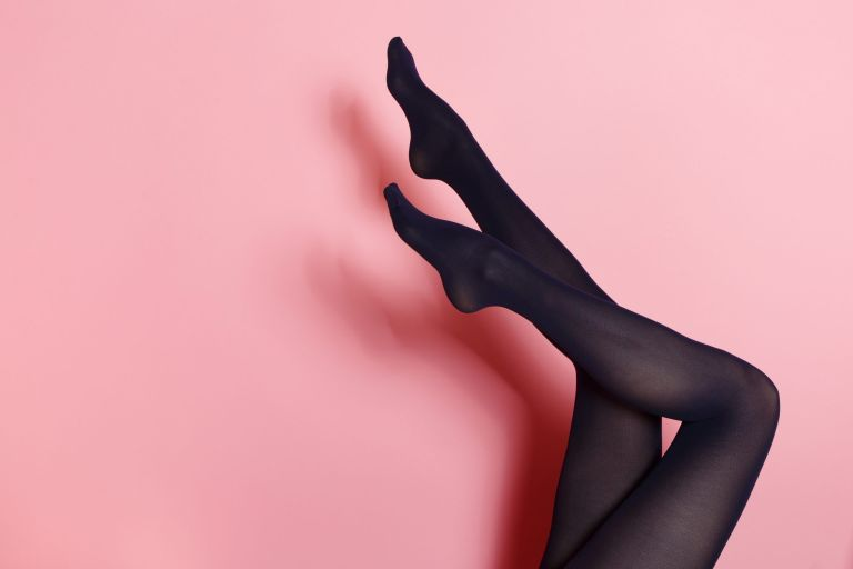woman wearing tights on colourful background