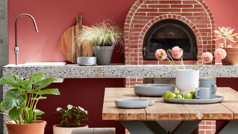 roost episode 4 - a terracotta red outdoor kitchen with bench seating and pizza oven - Pic-credit-Little-Greene.-LG-2020---Exterior-Paints-09