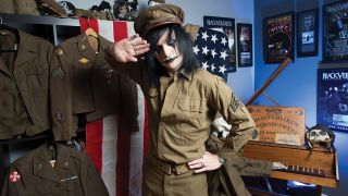 A photograph of Jinxx from Black Veil Brides, saluting with his military collection