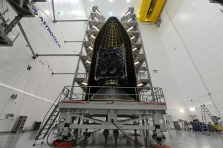The Wideband Global SATCOM 9 communications satellite for the U.S. military is encapsulated in the payload fairing of a United Launch Alliance Delta IV rocket ahead of planned March 18, 2017 launch from Cape Canaveral Air Force Station in Florida.