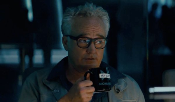 Godzilla: King of the Monsters Dr. Stanton sipping his coffee while saying something snarky