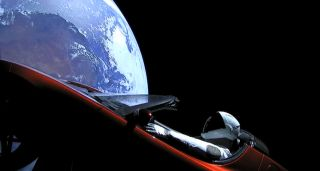 "A Tesla Roadster, carrying a dummy passenger named ""Starman,"" orbits the Earth after launching into space on the Falcon Heavy on Feb. 6, 2018."