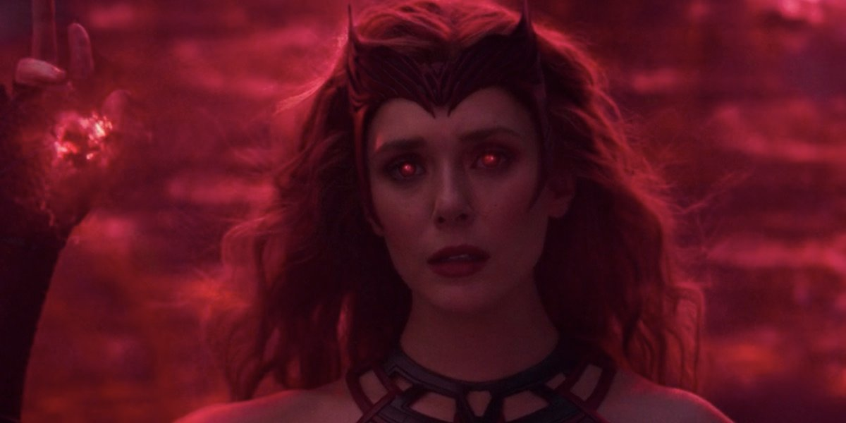 Costumed Scarlet Witch using her powers in WandaVision