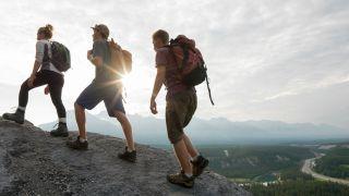 Three hikers on a ridge