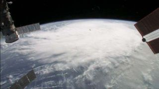 Aboard the International Space Station, an Expedition 28 crew member captured views of intensifying Hurricane Irene from an altitude of 225 miles at 3:33 p.m. EDT on Aug. 22, 2011, as the tropical system passed to the north of Hispaniola.