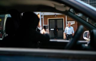 Peter Barlow and Carla fail to spot a car approaching and a gun pointing at them!