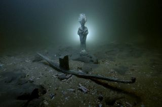 Divers have discovered the remains of three Roman-era shipwrecks, along with a votive bark likely dedicated to the god Osiris, off the coast of Alexandria, Egypt.