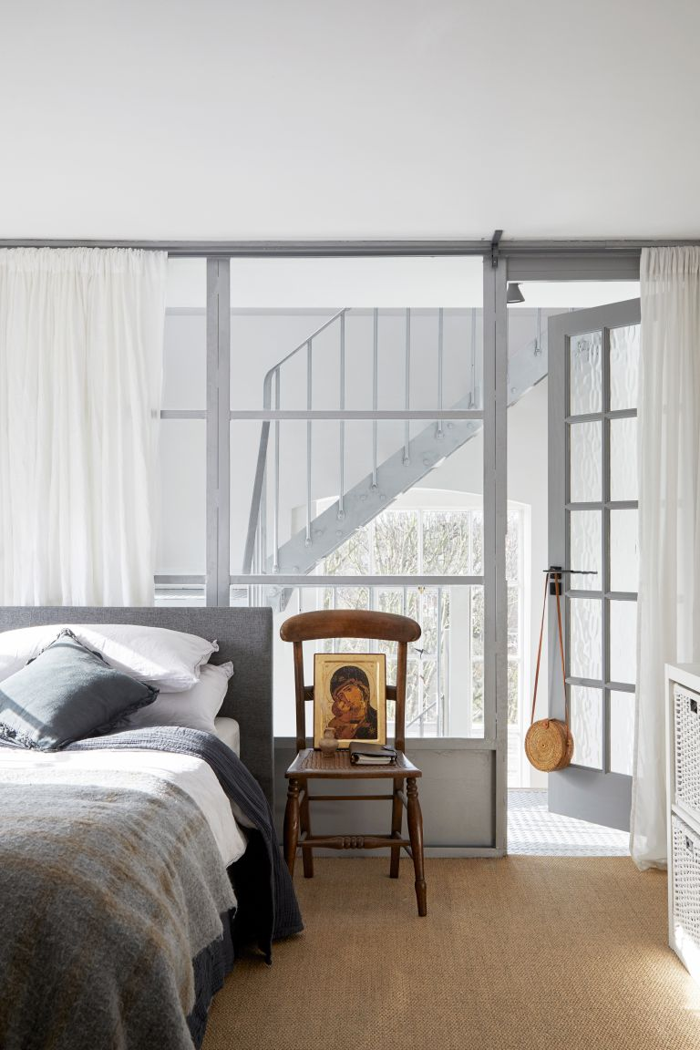 Grey bedroom with glass walls