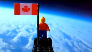 This still from a video uploaded to YouTube by Toronto 17-year-olds Mathew Ho and Asad Muhammad shows their homemade balloon launch of a Lego minifigure into the stratosphere to catch views of near space.