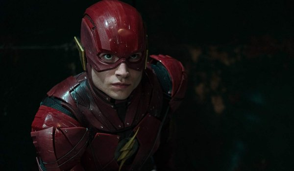 Justice League The Flash takes a runner's stance, ready to run