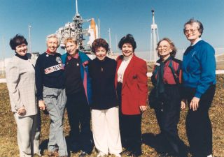 Jerrie Cobb, third from left, and other members of the First Lady Astronaut Trainees, or Mercury 13, visited Space Shuttle Discovery before the launch of STS-63 in 1995.