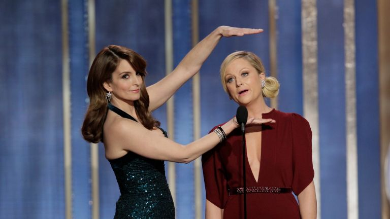 BEVERLY HILLS, CA - JANUARY 13: In this handout photo provided by NBCUniversal, L to R Tina Fey and Amy Poehler host the 70th Annual Golden Globe Awards at the Beverly Hilton Hotel International Ballroom on January 13, 2013 in Beverly Hills, California.
