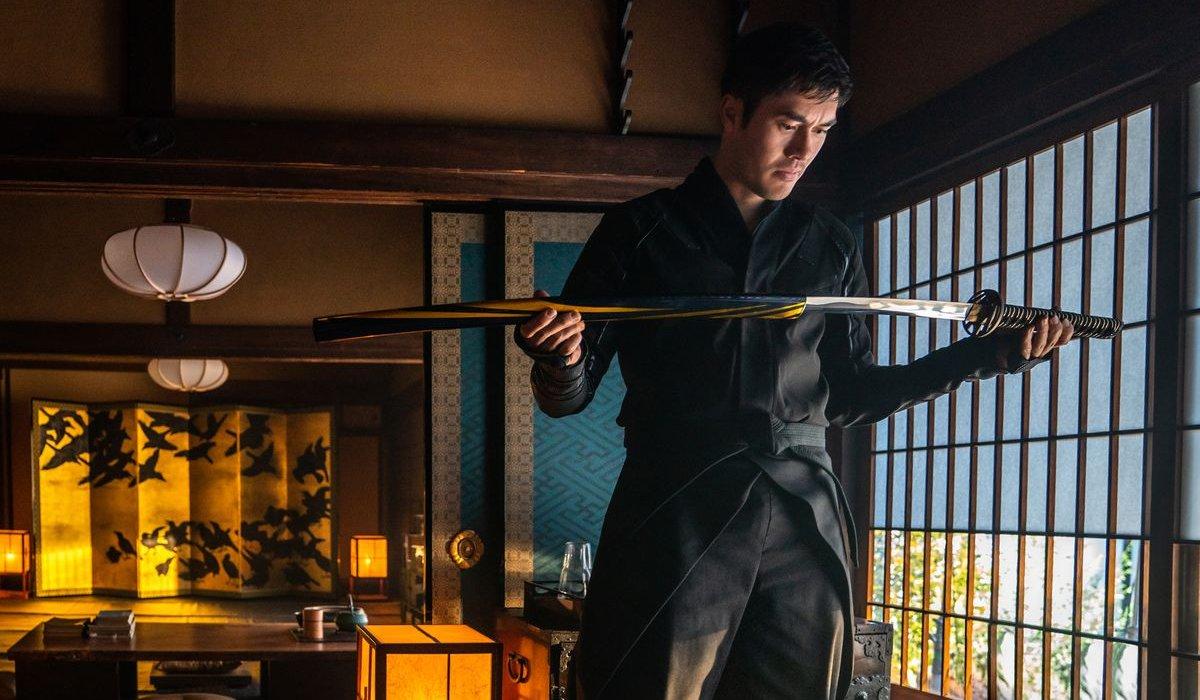 Henry Golding examines his sword carefully in Snake Eyes.
