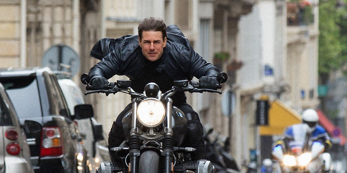 Ethan Hunt riding a motorcycle at top speed in Mission: Impossible - Fallout