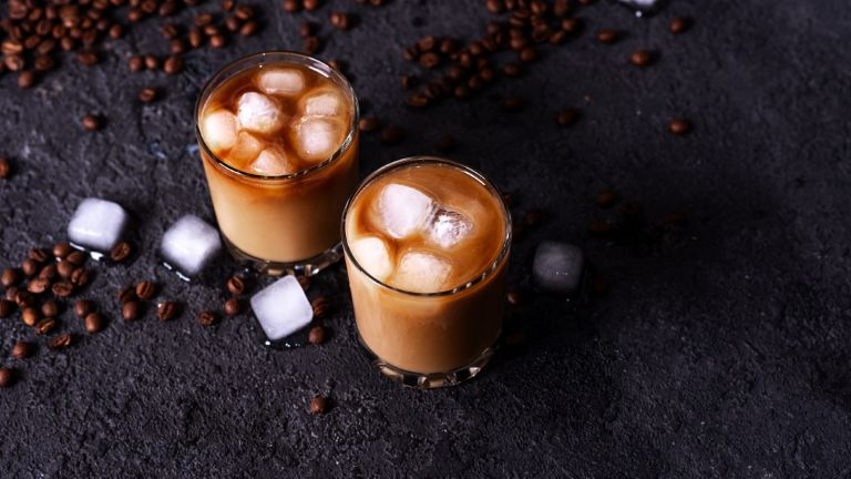 Coffee tonic - Iced coffee in a tall glass with cream poured over