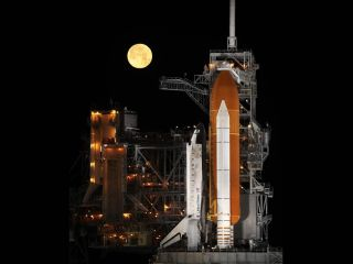 Space shuttle Discovery at Launch Pad with moon
