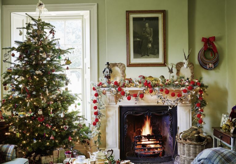 Christmas tree and lit fire in Cumbrian farmhouse