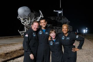 The Inspiration4 crewmembers — Chris Sembroski, Jared Isaacman, Hayley Arceneaux and Sian Proctor — seen at the rollout of the Falcon 9 rocket and Crew Dragon capsule that will carry them to orbit.