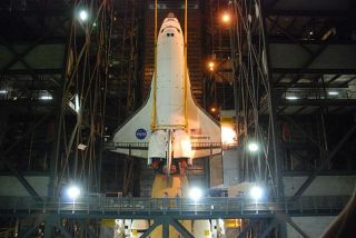 The space shuttle is moved into position for it's external tank and solid rocket boosters for the STS-133 mission to the International Space Station.