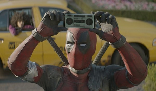 Deadpool 2 Deadpool plays music on his phone, in front of his cab