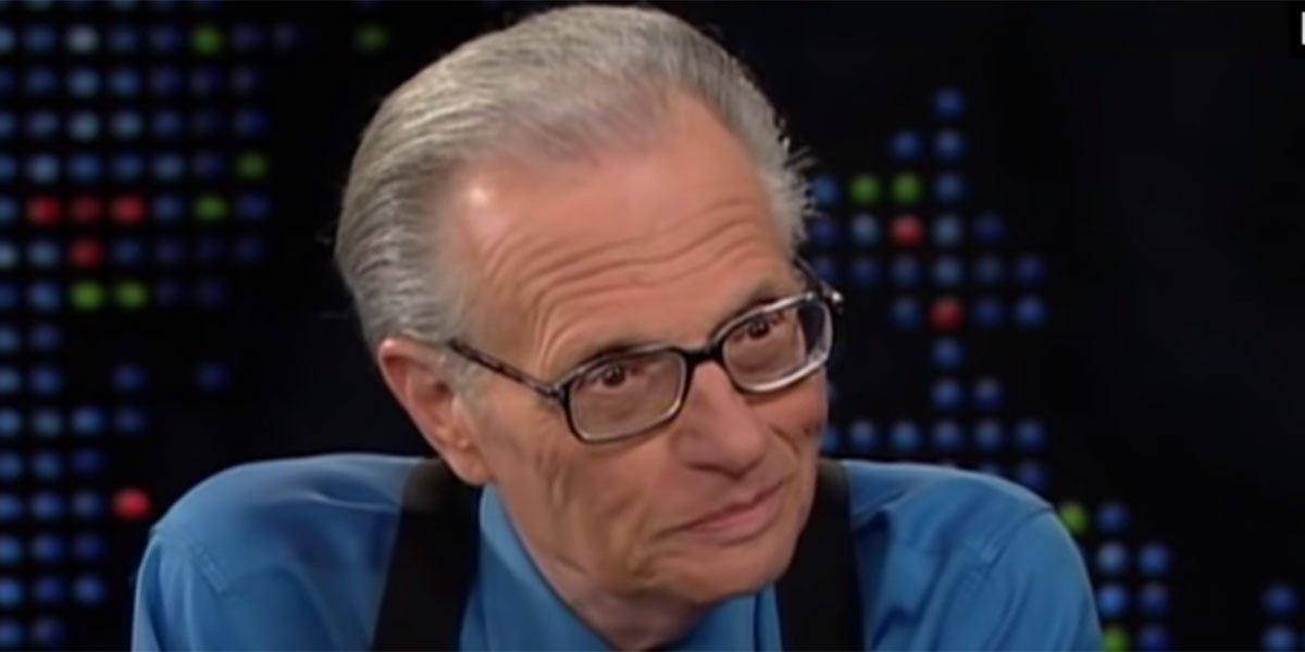 Larry King doing an interview.