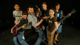 Actor Jack Black stars in new comedy The School of Rock, which we feature in Fall Sneaks. With co–stars, from left, Robert Tsai, Joey Gaydos Jr., Jack Black, Kevin Clark, Miranda Cosgrove and Rebecca Brown