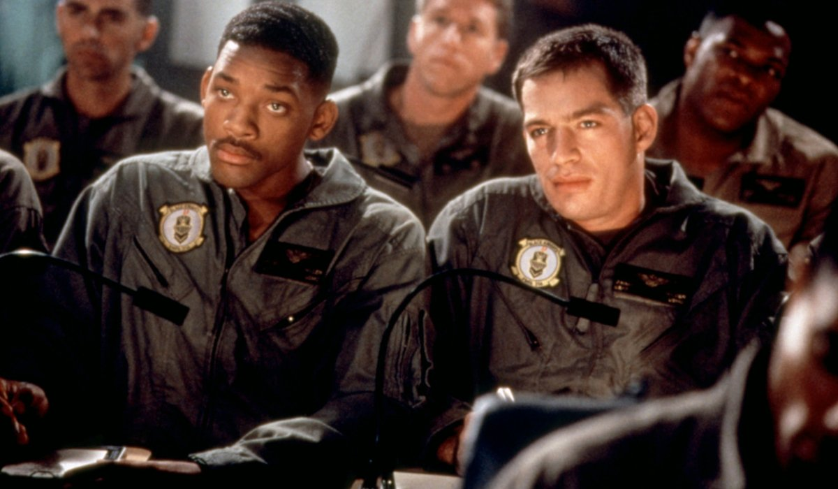 Independence Day Will Smith and Harry Connick Jr side by side in a briefing
