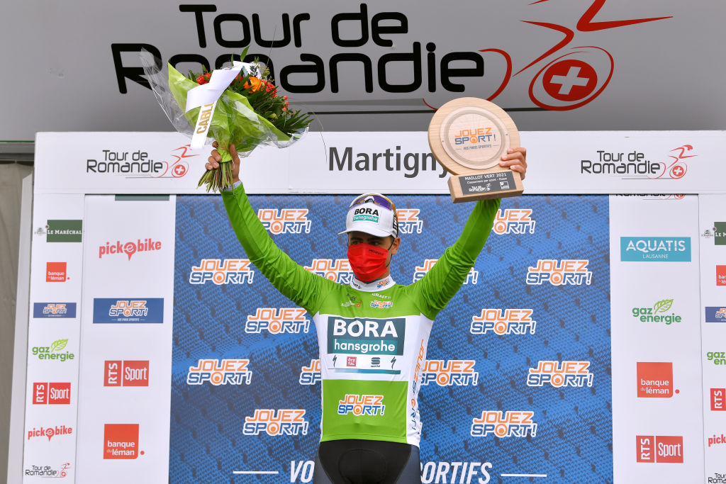 MARTIGNY SWITZERLAND APRIL 28 Peter Sagan of Slovakia and Team Bora Hansgrohe Green Points Jersey celebrates at podium during the 74th Tour De Romandie 2021 Stage 1 a 1681km stage from Aigle to Martigny Trophy Mask Covid safety measures Flowers TDR2021 TDRnonstop UCIworldtour on April 28 2021 in Martigny Switzerland Photo by Luc ClaessenGetty Images