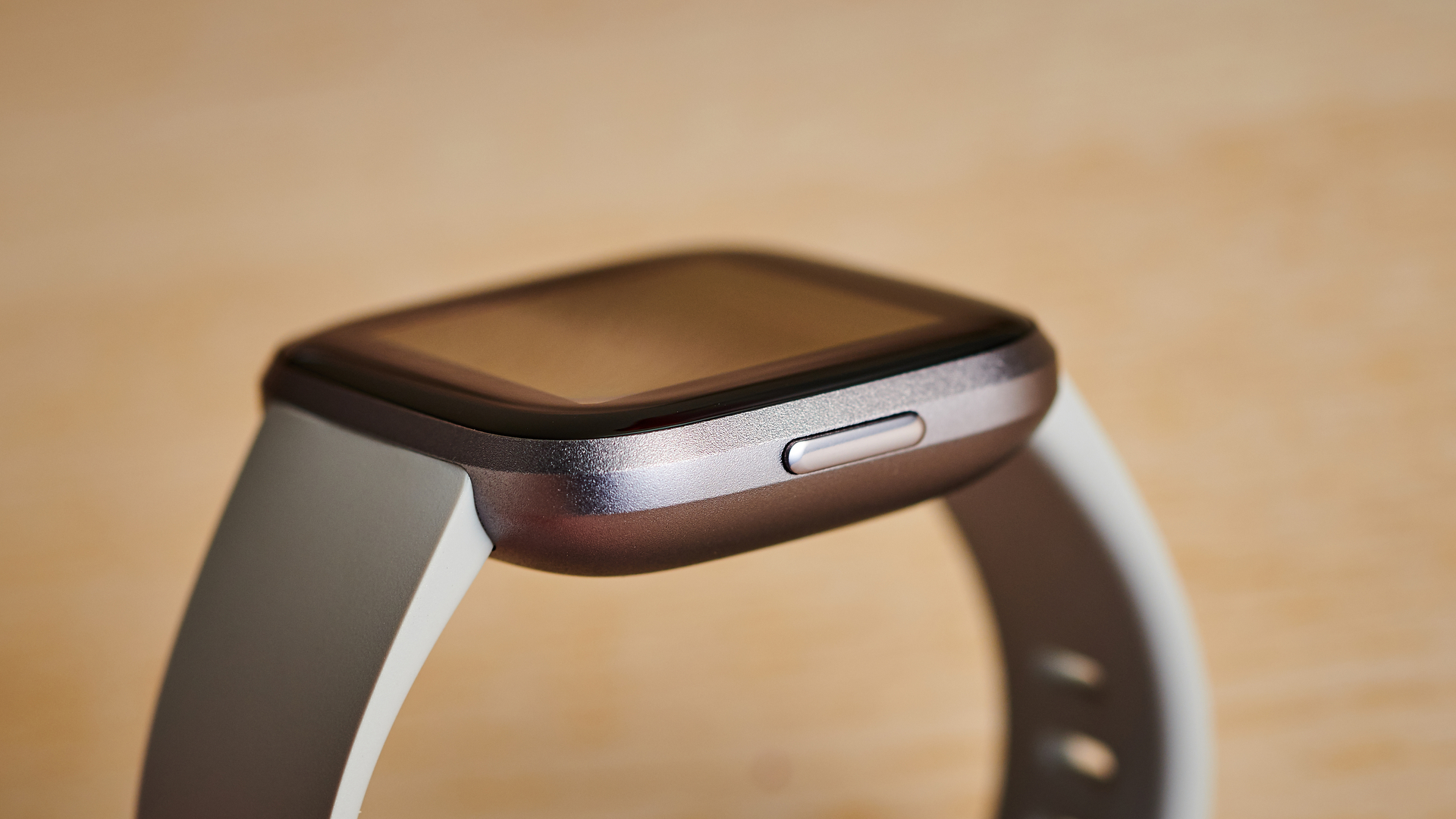 A single button gives the Versa 2 a more minimalist look