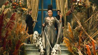 Emma Thompson as The Baroness in Cruella with dalmatians