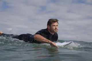 Surfing fan Chris Hemsworth has felt the presence of sharks while out on the ocean.