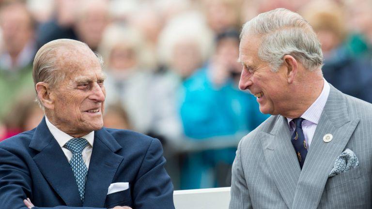 Prince Philip and Prince Charles share a joke