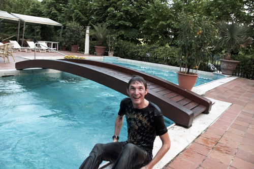 Frank Schleck climbs out of swimming pool