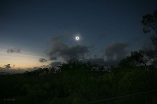A total solar eclipse with halo over Queensland, Australia by Tunc Tezel