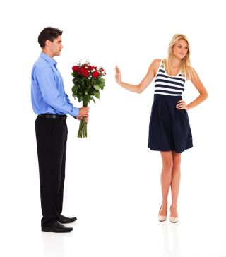 woman rejecting man's flowers