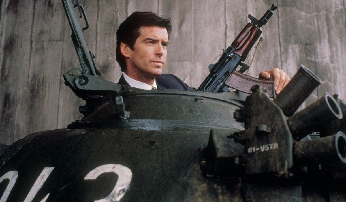 Goldeneye Pierce Brosnan holds a machine gun while riding a tank