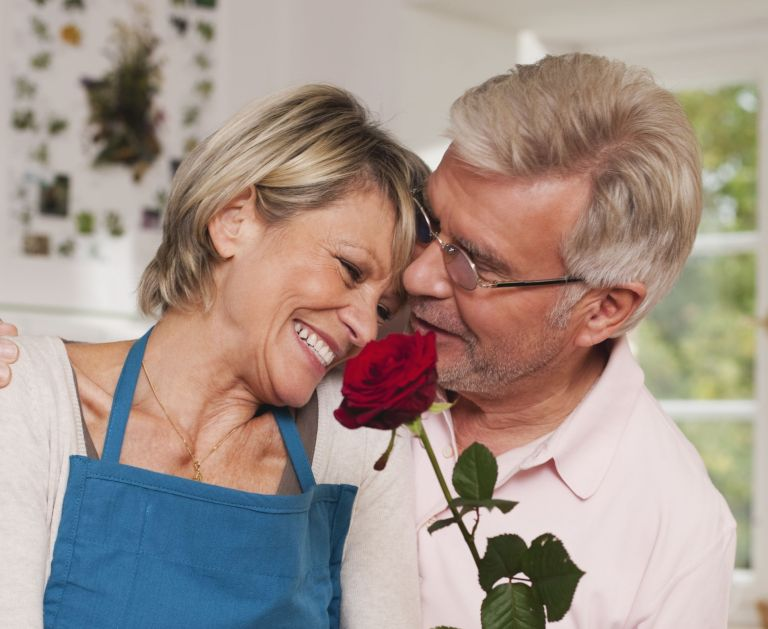 Couple holding a rose