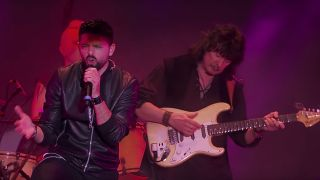 A picture of Ronnie Romero and Ritchie Blackmore on stage