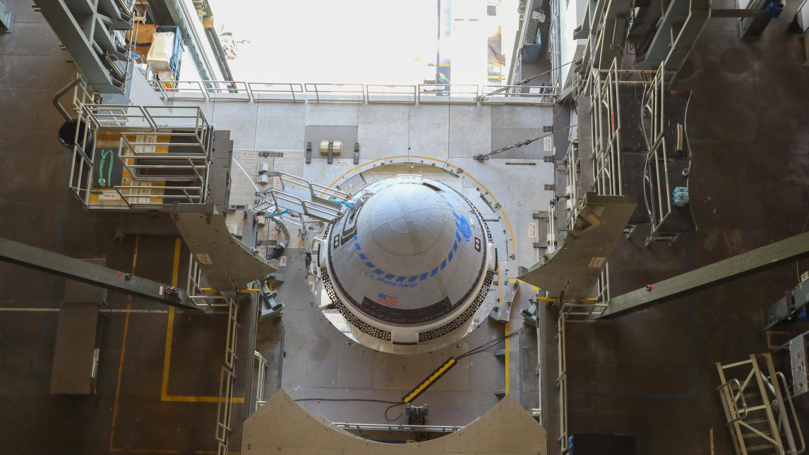 Boeing's Starliner for the OFT-2 mission is pictured inside the Vertical Integration Facility, at Space Launch Complex 41 at Cape Canaveral Space Force Station in Florida, on July 28, 2021.