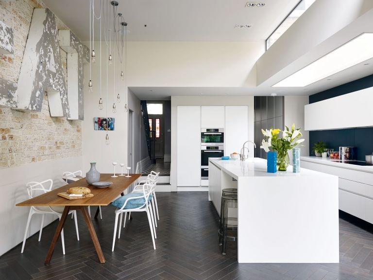 bright white open plan kitchen diner
