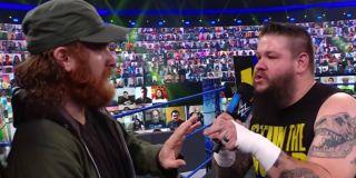 Sami Zayn being threatened by Kevin Owens