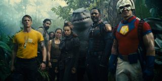 A handful of The Suicide Squad members lined up in the jungle.