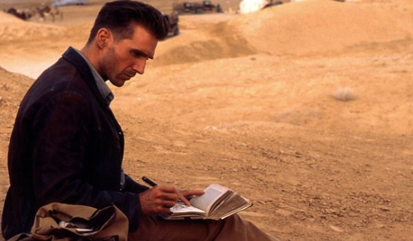 The English Patient Ralph Fiennes writing in his journal in the desert