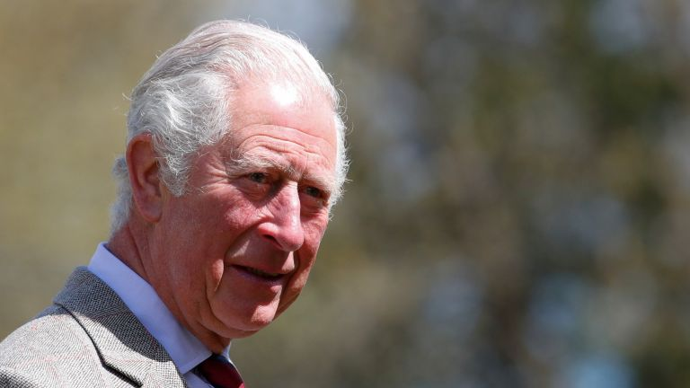 Prince Charles, Prince of Wales speaks with soldiers of the Welsh Guards during a visit to Combermere Barracks on May 5, 2021 in Windsor, England