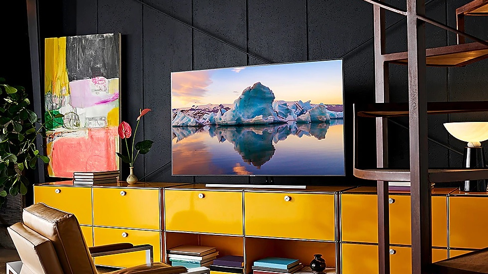 The Samsung Q85 QLED TV displayed in a home theater setup