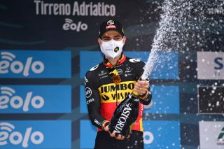 SAN BENEDETTO DEL TRONTO ITALY MARCH 16 Podium Wout Van Aert of Belgium and Team Jumbo Visma Celebration during the 56th TirrenoAdriatico 2021 Stage 7 a 101km Individual Time Trial stage from San Benedetto del Tronto to San Benedetto del Tronto ITT Champagne Mask Covid Safety Measures TirrenoAdriatico on March 16 2021 in San Benedetto del Tronto Italy Photo by Tim de WaeleGetty Images